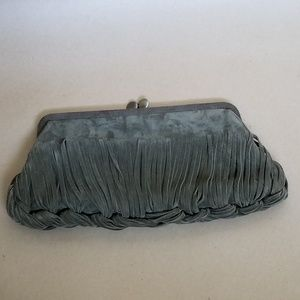 Sondra Roberts Bags - Sondra Roberts green suede braided fringe clutch